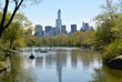 A reflective view of the NYC skyline from Central Park