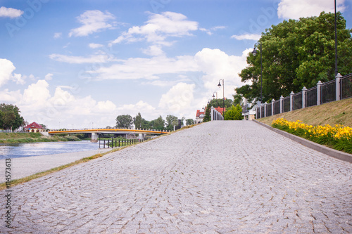 Foto op Aluminium Stad aan het water Konin, Poland - June 18, 2016: Embankment of polish Warta river in town Konin