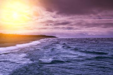 FototapetaSunset over stormy sea
