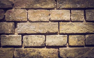 Fototapeta Обожженный глиняный кирпич. Древняя кладка крепостной стены