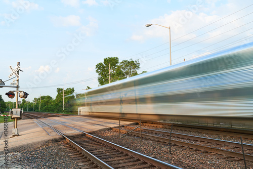 Passenger Train Cars Blur Along the Tracks Canvas Print