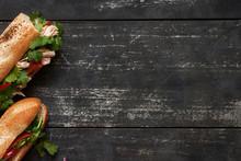 Two Tuna Sandwich On Dark Wood...