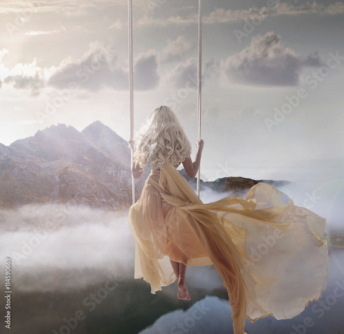 Foto auf AluDibond Artist KB Attractive lady sitting on the swing above the calm lake