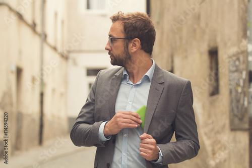 Fotomural  Modern guy using cellphone outdoors.