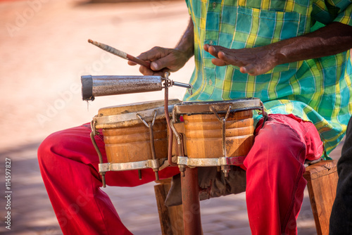 Photo  Street musician playing drums in Trinidad, Cuba