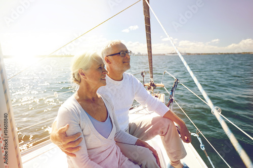 In de dag Schip senior couple hugging on sail boat or yacht in sea