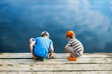 Children Play Near The River. ...