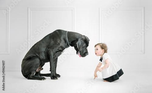 Poster Artist KB Little girl posing against a big dog