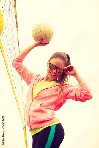 obraz lub plakat Woman volleyball player outdoor on court