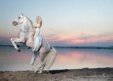 Portrait Of A Blond Woman Riding A Horse