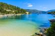 Beach with turquoise sea in bay near Fiskardo village, Kefalonia island, Greece