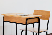 School Classroom With School Desks With Chair On White Backgroun