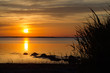 Summer sunset by a calm coast