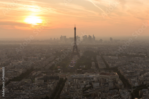 Aluminium Prints Paris Aerial view of Paris with Eiffel tower and major business district of La Defence in background at sunset.