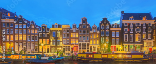 Poster Amsterdam Amstel river, canals and night view of beautiful Amsterdam city. Netherlands
