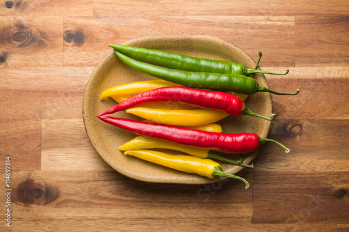 Staande foto Hot chili peppers Different colors chilli peppers.