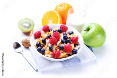 In de dag Buffet, Bar Breakfast with muesli, milk, berries, orange, green apple, kiwi and walnuts
