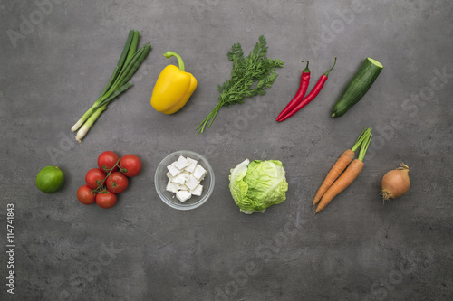 Wall Murals Spices Fresh ingredients. Top view on vegetables, red beans and cheese in bowls on grey kitchen table.