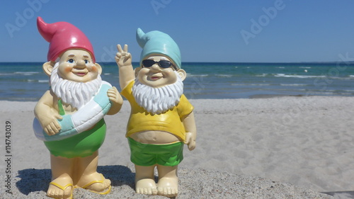 Fotografie, Obraz  Two garden gnomes  on vacation at sea