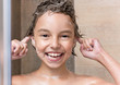 Girl bathing under shower