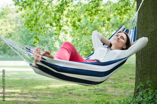 Fotografie, Obraz  Woman Relaxing In Hammock