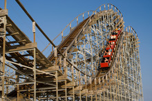 Old Wooden Rollercoaster At An Amusement Park