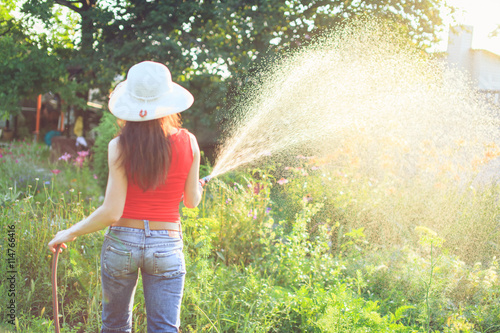 Stampa su Tela Watering  with a hose,  gardening concept