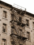 dilapidated industrial building with rusty fire escape with faci - 114771084
