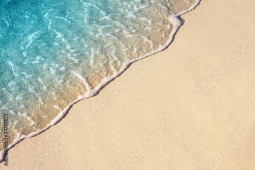 Staande foto Strand Soft wave of sea on the sandy beach