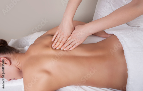 Fotografie, Obraz  Connective tissue massage on a muscle group of a woman's back