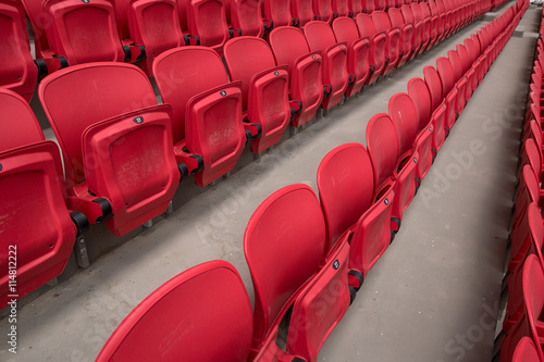 Photo  Bright red stadium seat