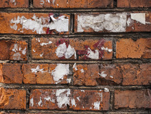 White  Torn Posters On Grunge Old Brick Walls - Texture