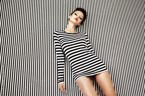 fashion woman in striped dress on  background Fototapeta