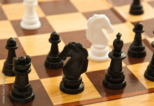 Fotografie, Obraz black and white chess figures on a board