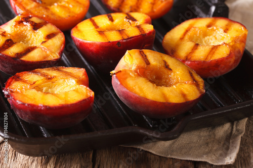 Ripe peaches on a a grill pan close-up. Horizontal