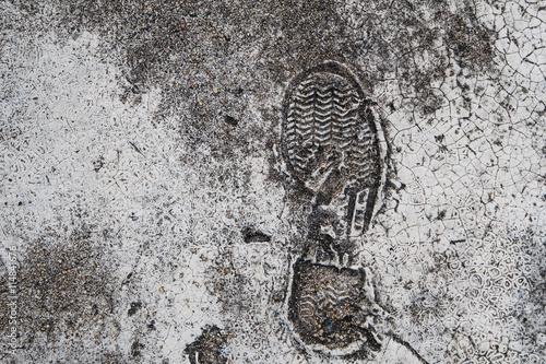 Fotografering  Foot print on grunge concrete texture