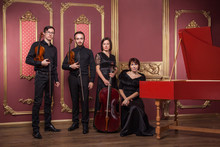 Classical Music Quartet Posing After The Concert.