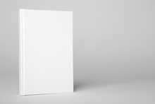Real Hardcover White Book On A Gray Background