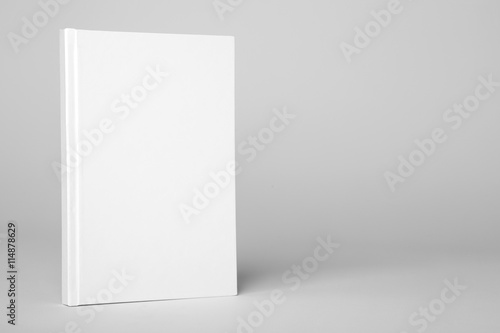 Fotografering  Real hardcover white book on a gray background