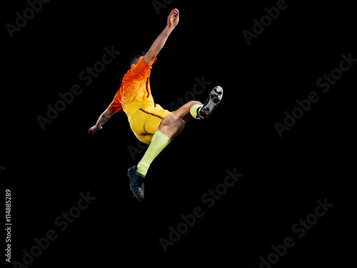 Professional football player in red uniform in jump isolated
