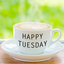 Happy Tuesday On Coffee Cup Over Natural Background