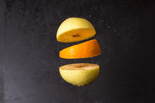 Levitating Fresh Sliced Apple And Orange