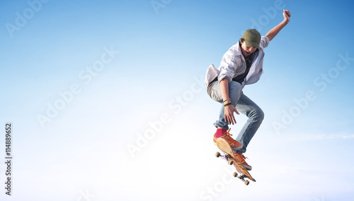 Valokuvatapetti Skater on the sky background. Sport and active life concept