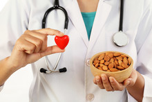 Doctor Holding A Bowl Of Almonds - Health Concept