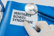 Blue folder with patient files with IBS (Irritable Bowel Syndrome) diagnosis.