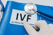 IVF (in vitro fertilisation concept). Blue folder with patient files.