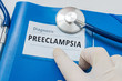 Blue folder with patient files with Preeclampsia diagnosis.