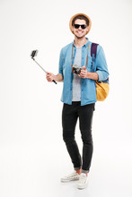 Cheerful Young Tourist, Old Camera And Smartphone On Selfie Stick