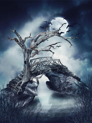 Plakat Martwe drzewo i stary most na rzece nocą