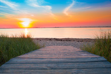 Wooden Beach Path To Sand And Sea At Sunset